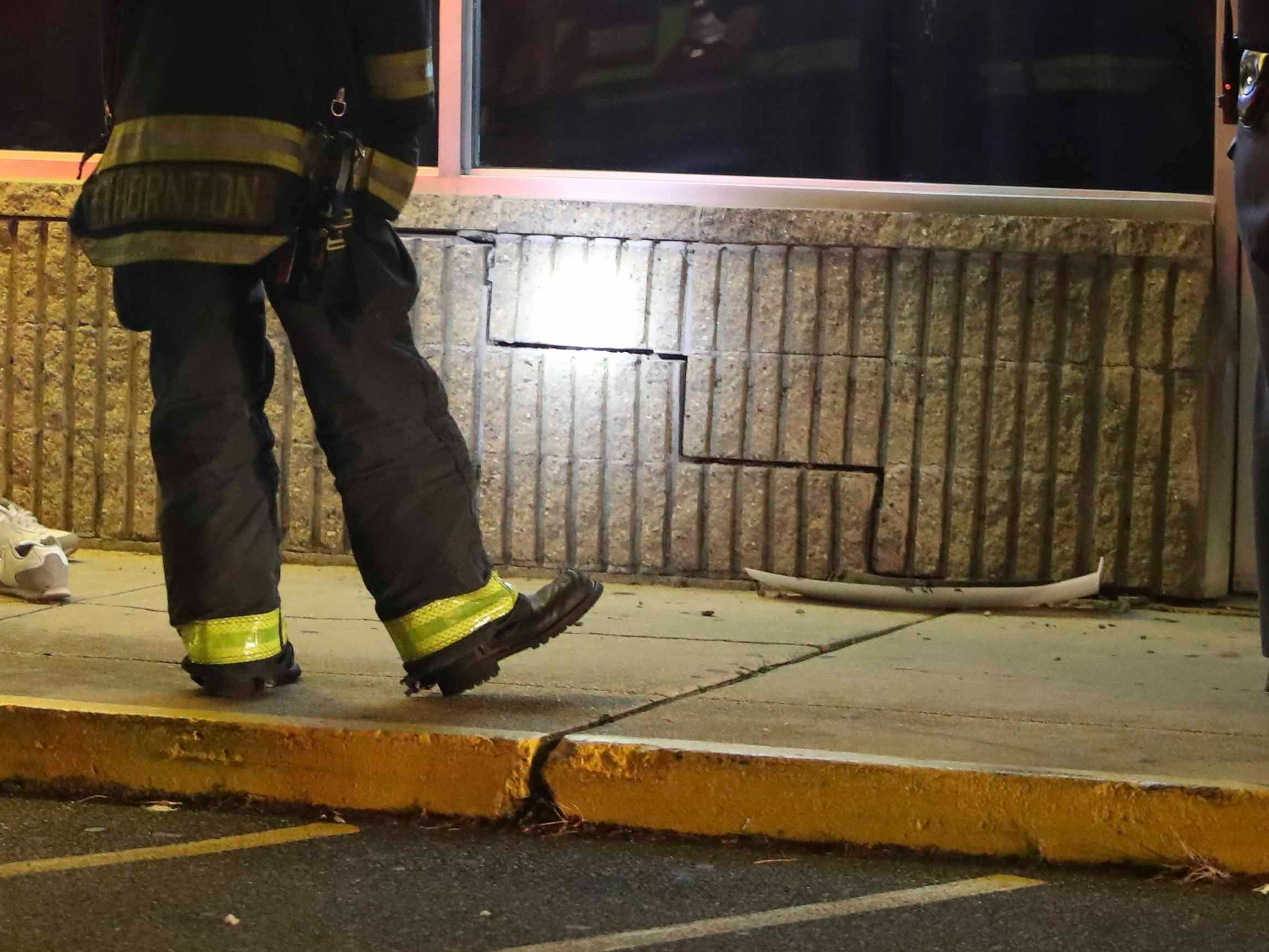 Shoes and cracked, displaced blocks are left at the scene after a woman was reported to have been struck by a van and pinned to a wall in the Basin Shoppes on East Basin Road in New Castle about 11:10 p.m. Friday.