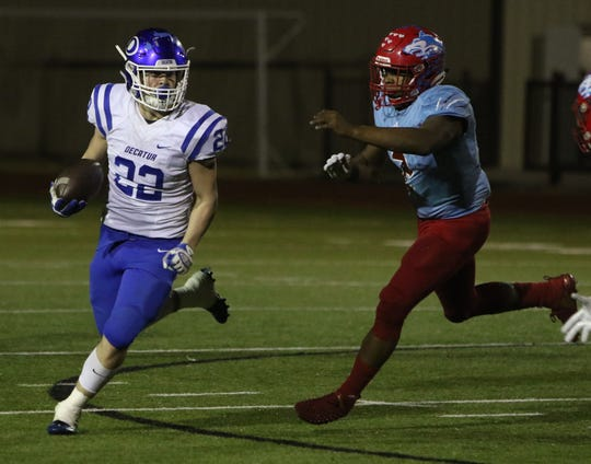 Hirschi linebacker Fred Fleeks chases Decatur running back Gunner Ragsdale in a Region I-4A Division I playoff matchup, Nov. 230, 2018, at Newton Field in Graham.