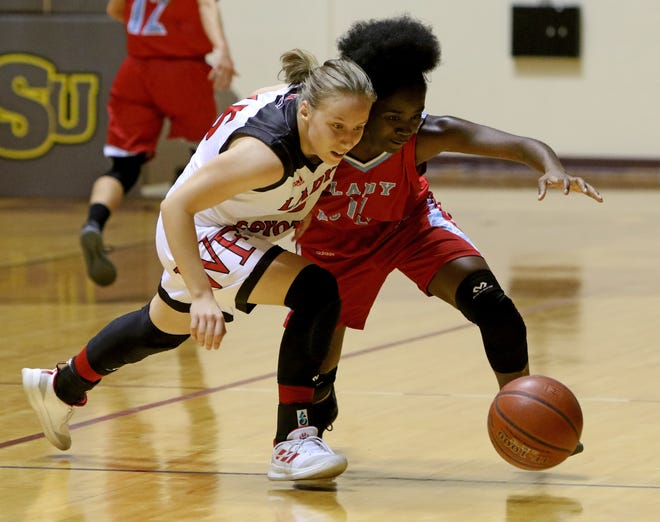 Wichita Falls High School's Iskra Stonojavic and Hirschi's Patience Murphy go after the loose ball Saturday, Dec. 1, 2018, at D.L. Ligon Coliseum at Midwestern State University.