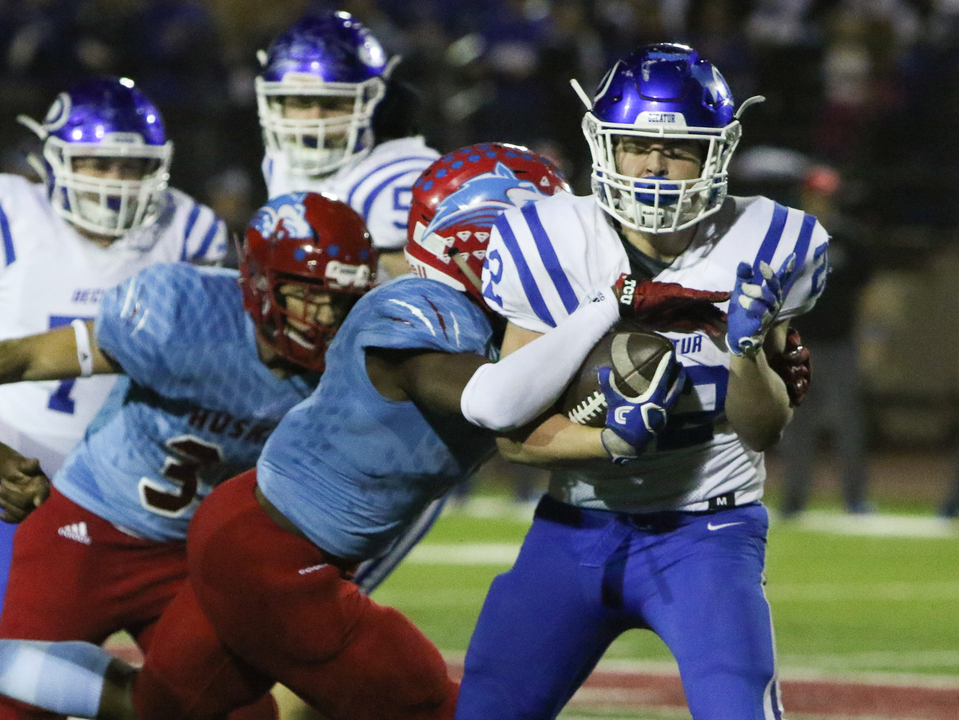 Hirschi's Daimarqua Foster tackles Decatur's Gunner Ragsdale Friday, Nov. 30, 2018, at Newton Field in Graham.