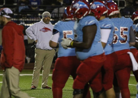 Hirschi head football coach Danny Youngs watches as his team warms up after the lightning delay before the start of the playoff game against Decatur Friday, Nov. 30, 2018, at Newton Field in Graham.