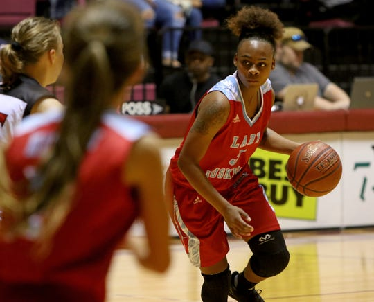Hirschi's Eternity Hull dribbles in the game against Wichita Falls High School Saturday, Dec. 1, 2018, at D.L. Ligon Coliseum at Midwestern State University.