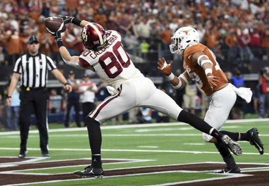 Oklahoma tight end Grant Calcaterra (80) hauls in a touchdown pass from quarterback Kyler Murray in front Texas defensive back Brandon Jones during the first half of the Big 12 Conference championship NCAA college football game on Saturday, Dec. 1, 2018, in Arlington, Texas.