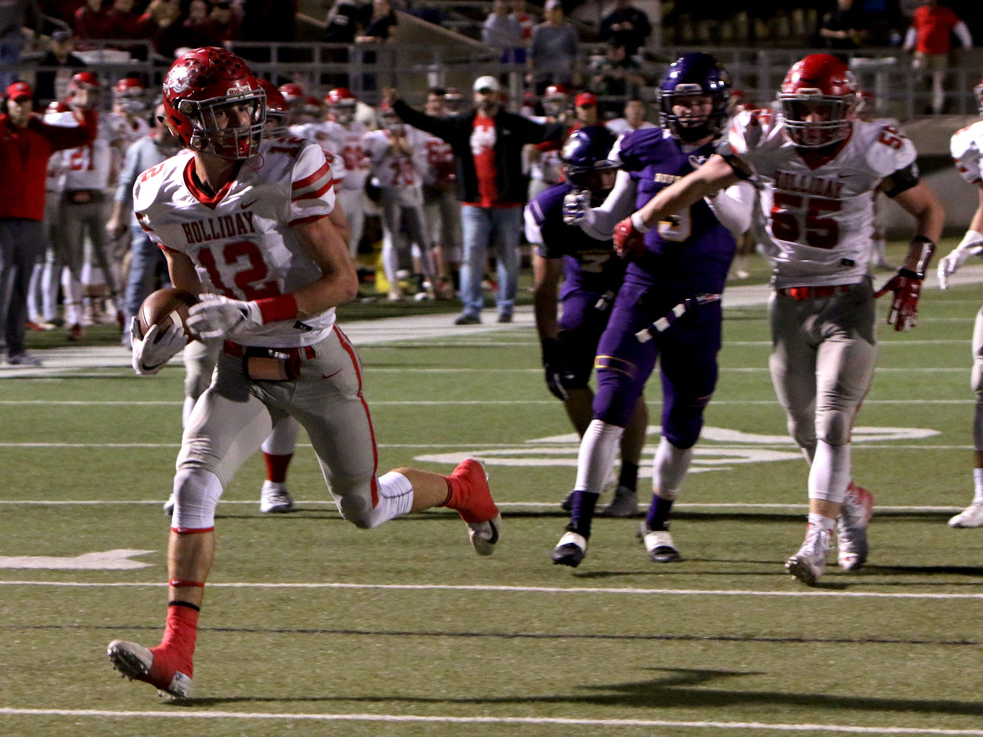 Holliday's Connor Cox (12) scores a touchdown nearly untouched against Buffalo on Friday, Nov. 30, 2018, in the Region II-3A Div. II regional game at Birdville ISD Athletics Complex in North Richland Hills.