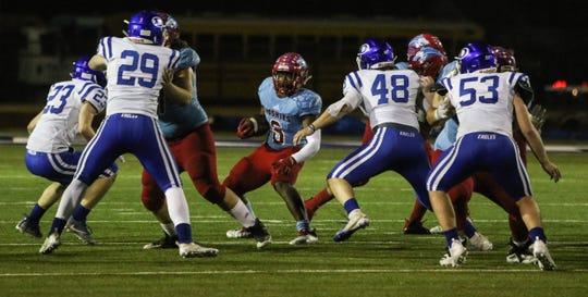 Hirschi's Daimarqua Foster looks for an opening at the line of scimmage against Decatur Friday, Nov. 30, 2018, at Newton Field in Graham.