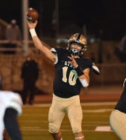 Rider quarterback Jacob Rodriguez (10) threw for a touchdown and ran for three more in the first half of the Raiders' game against Canyon Randall Friday night in Childress.