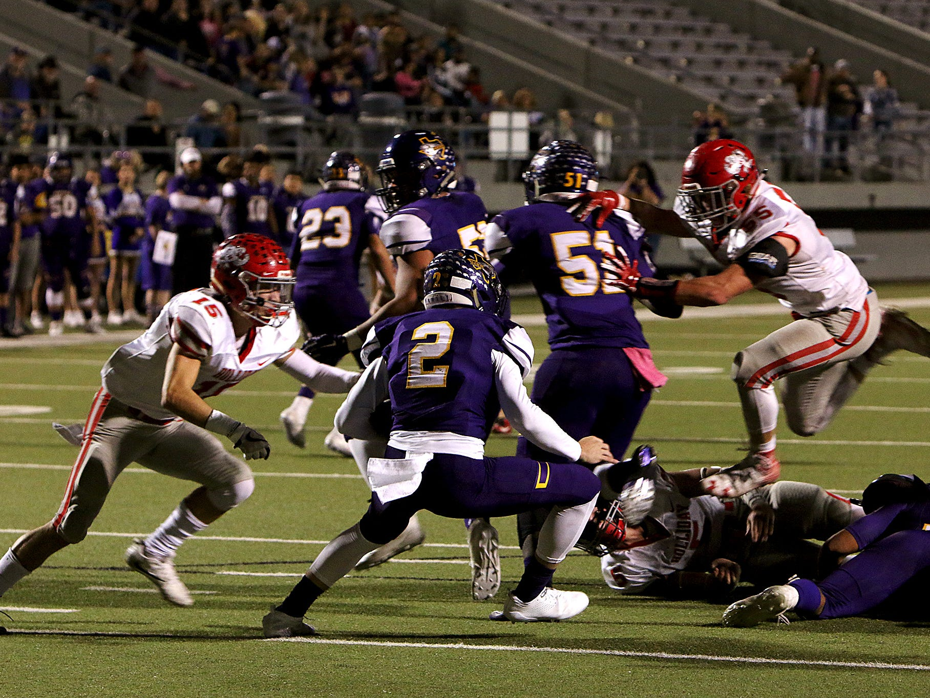 Holliday's Kase Patterson (15) and Tanner Bayard (55) meet at Buffalo quarterback Colton Green (2) on Friday, Nov. 30, 2018, in the Region II-3A Div. II regional game at Birdville ISD Athletics Complex in North Richland Hills.