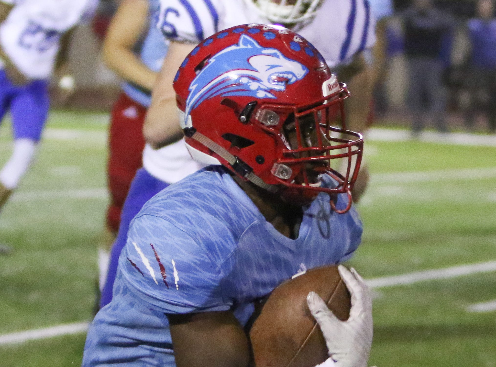 Hirschi's Tian Harrell runs for a first down against Decatur Friday, Nov. 30, 2018, at Newton Field in Graham.