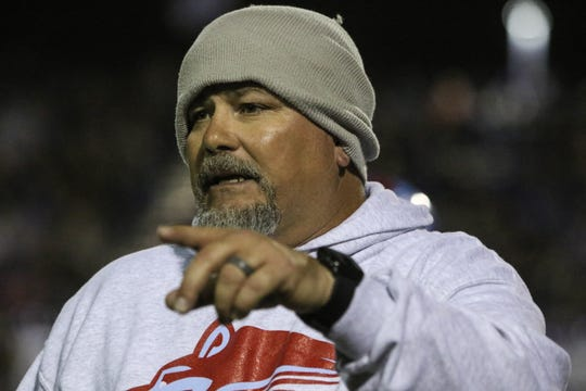 Hirschi head football coach Danny Youngs talks to his players in the playoff game against Decatur Friday, Nov. 30, 2018, at Newton Field in Graham.