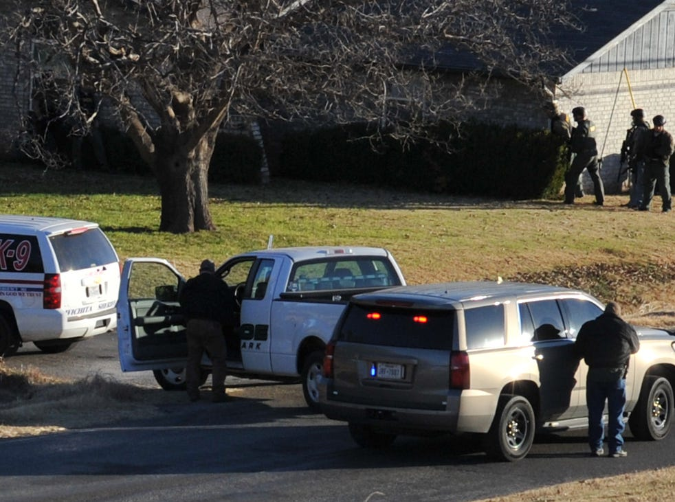 Members of the Wichita County SWAT team stage outside of a home where an armed suspect barricaded himself early Saturday morning.