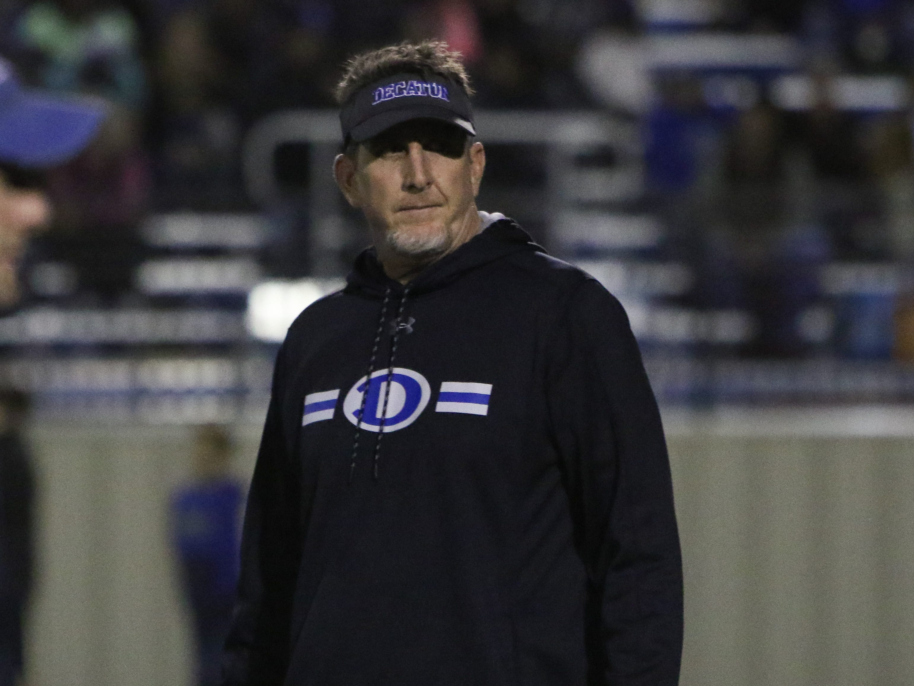 Decatur head football coach Mike Fuller watches his team warm up before the start of the playoff game against Hirschi after the lightning delay Friday, Nov. 30, 2018, at Newton Field in Graham.
