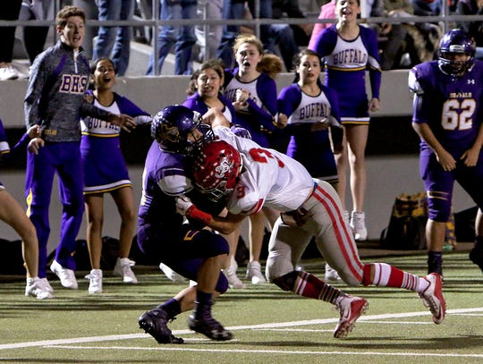 Holliday's Chase Borchardt (3) tackles Buffalo receiver Tony Rios (left) after he makes a catch on Friday, Nov. 30, 2018, in the Region II-3A Div. II regional game at Birdville ISD Athletics Complex in North Richland Hills.