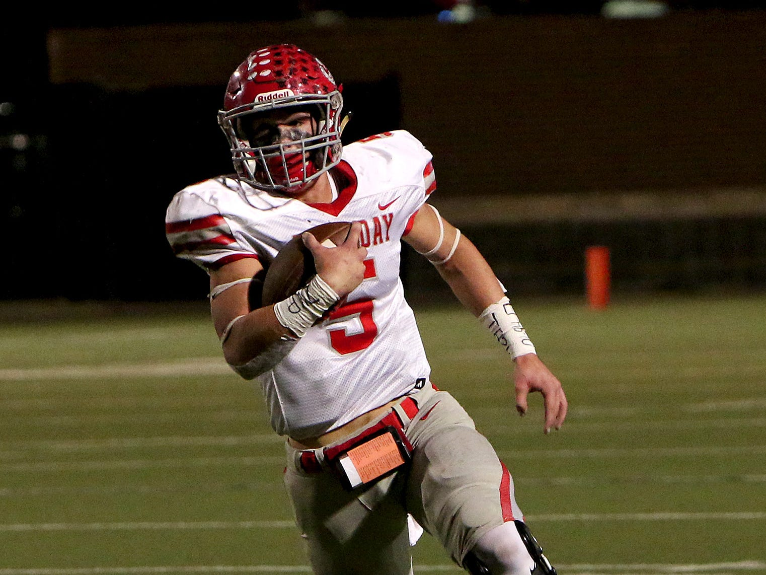 Holliday quarterback Jett Johnson keeps the ball on a rush attempt against Buffalo on Friday, Nov. 30, 2018, in the Region II-3A Div. II regional game at Birdville ISD Athletics Complex in North Richland Hills.
