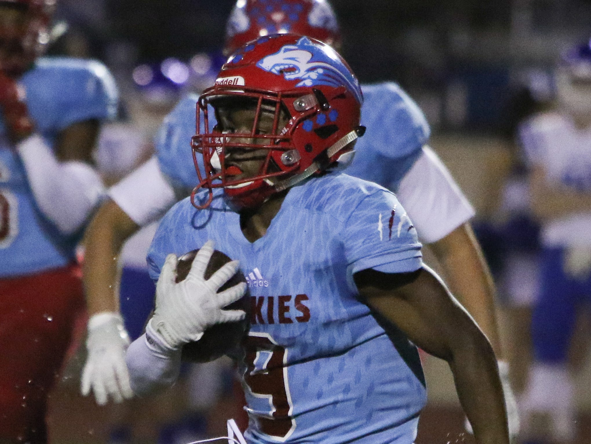 Hirschi's Tian Harrell runs around the line of scrimmage in the playoff game against Decatur Friday, Nov. 30, 2018, at Newton Field in Graham.