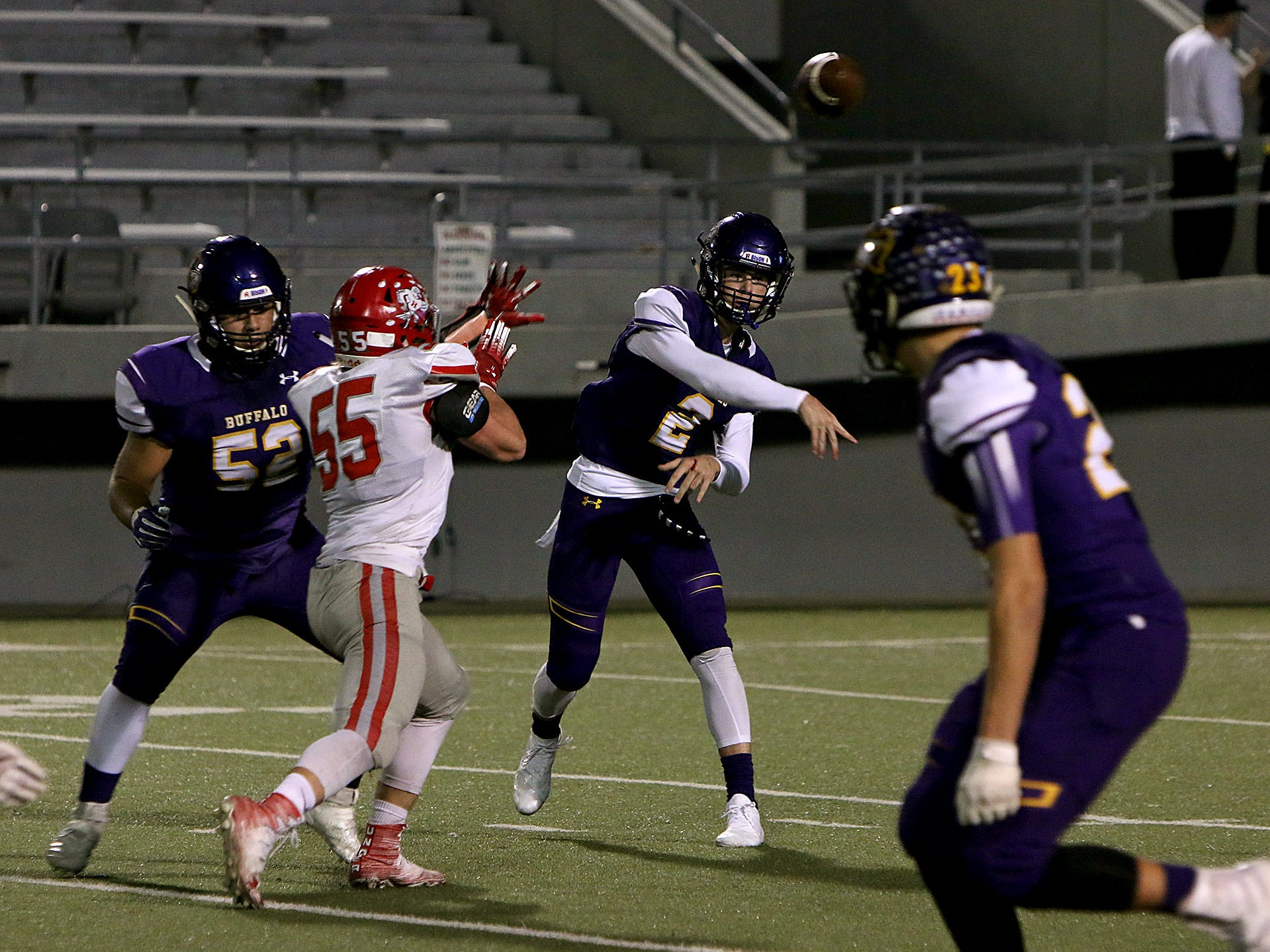 Buffalo's Colton Green (2) throws a screen pass as Holliday's Tanner Bayard (55) defends on Friday, Nov. 30, 2018, in the Region II-3A Div. II regional game at Birdville ISD Athletics Complex in North Richland Hills.