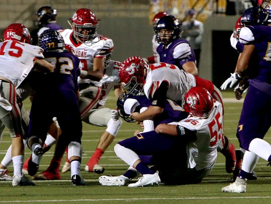 Holliday's Tanner Bayard (55) and Jake Turner (52) bring down Buffalo's Colton Green on Friday, Nov. 30, 2018, in the Region II-3A Div. II regional game at Birdville ISD Athletics Complex in North Richland Hills.