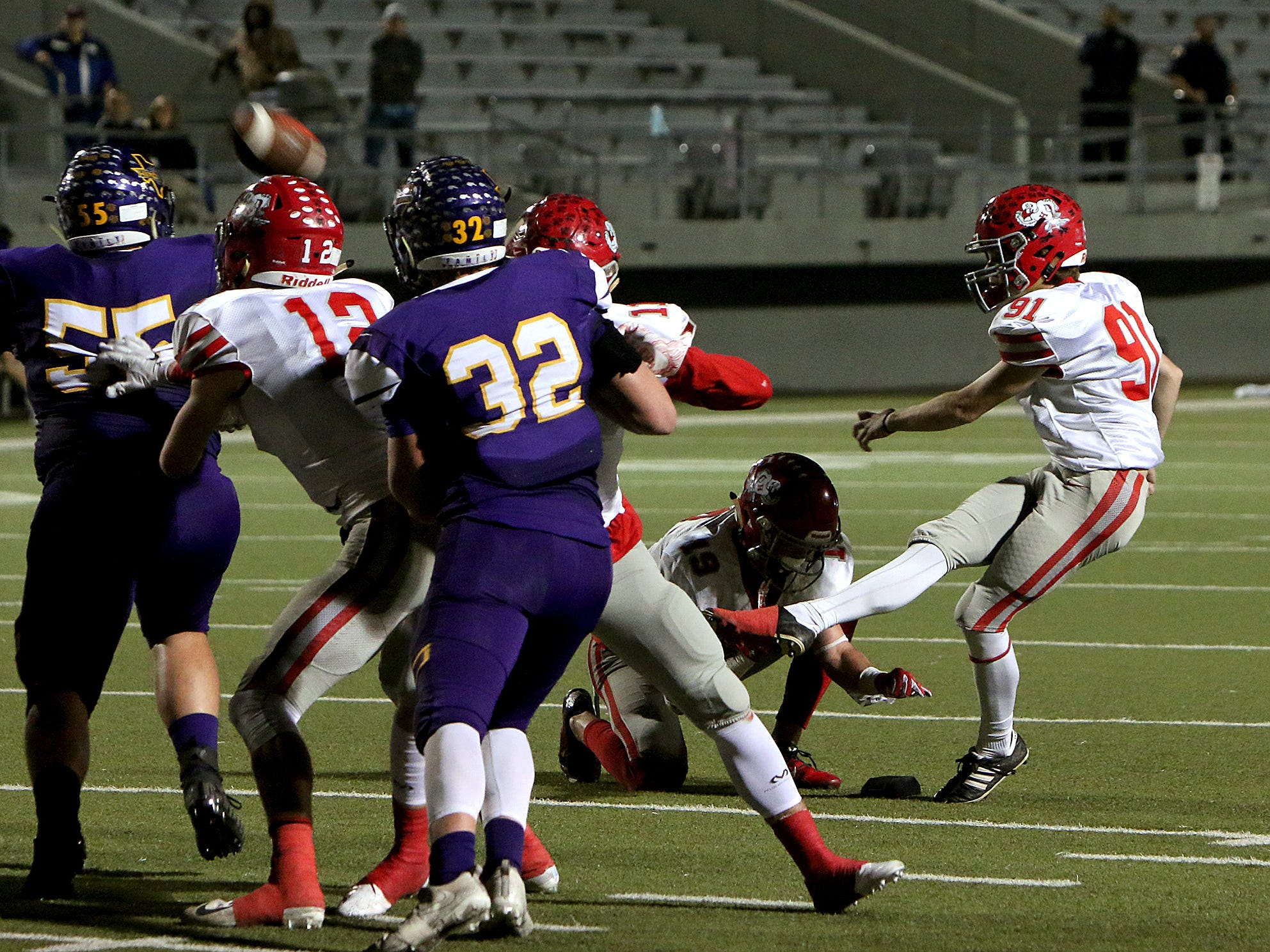 Holliday's Grayson Germany (91) makes a field goal near the end of the first half against Buffalo on Friday, Nov. 30, 2018, in the Region II-3A Div. II regional game at Birdville ISD Athletics Complex in North Richland Hills.