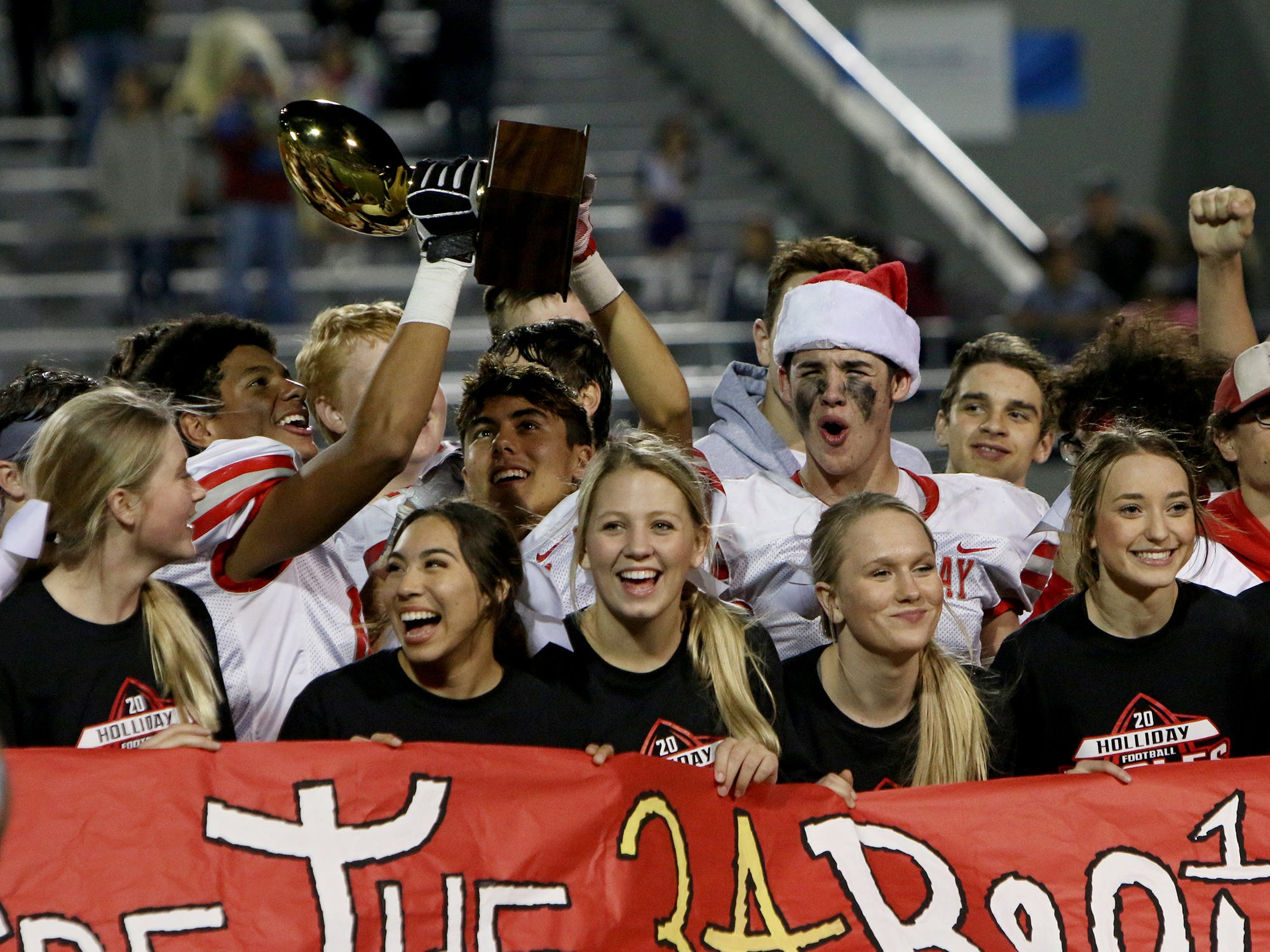 The Holliday Eagles celebrate their 38-9 win over Buffalo in the Region II-3A Div. II regional game Friday, Nov. 30, 2018, at Birdville ISD Athletics Complex in North Richland Hills.