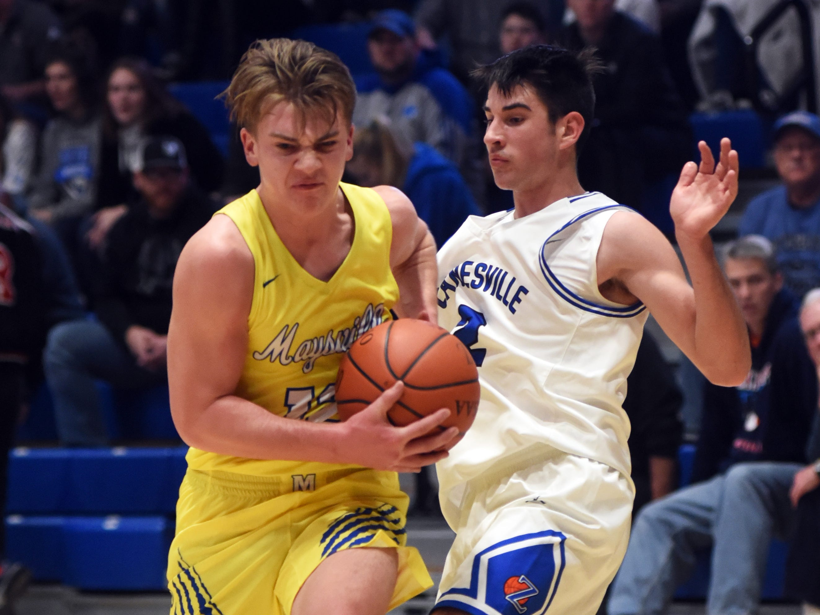 Adam Armstead, of Maysville, muscles into the lane against Zanesville's Avery Parmer.
