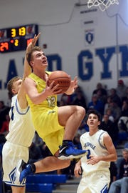 Adam Armstead soars through the lane during Maysville's 67-51 loss to Zanesville on Friday night in the ZHS Tip-Off Classic at Winland Memorial Gymnasium.