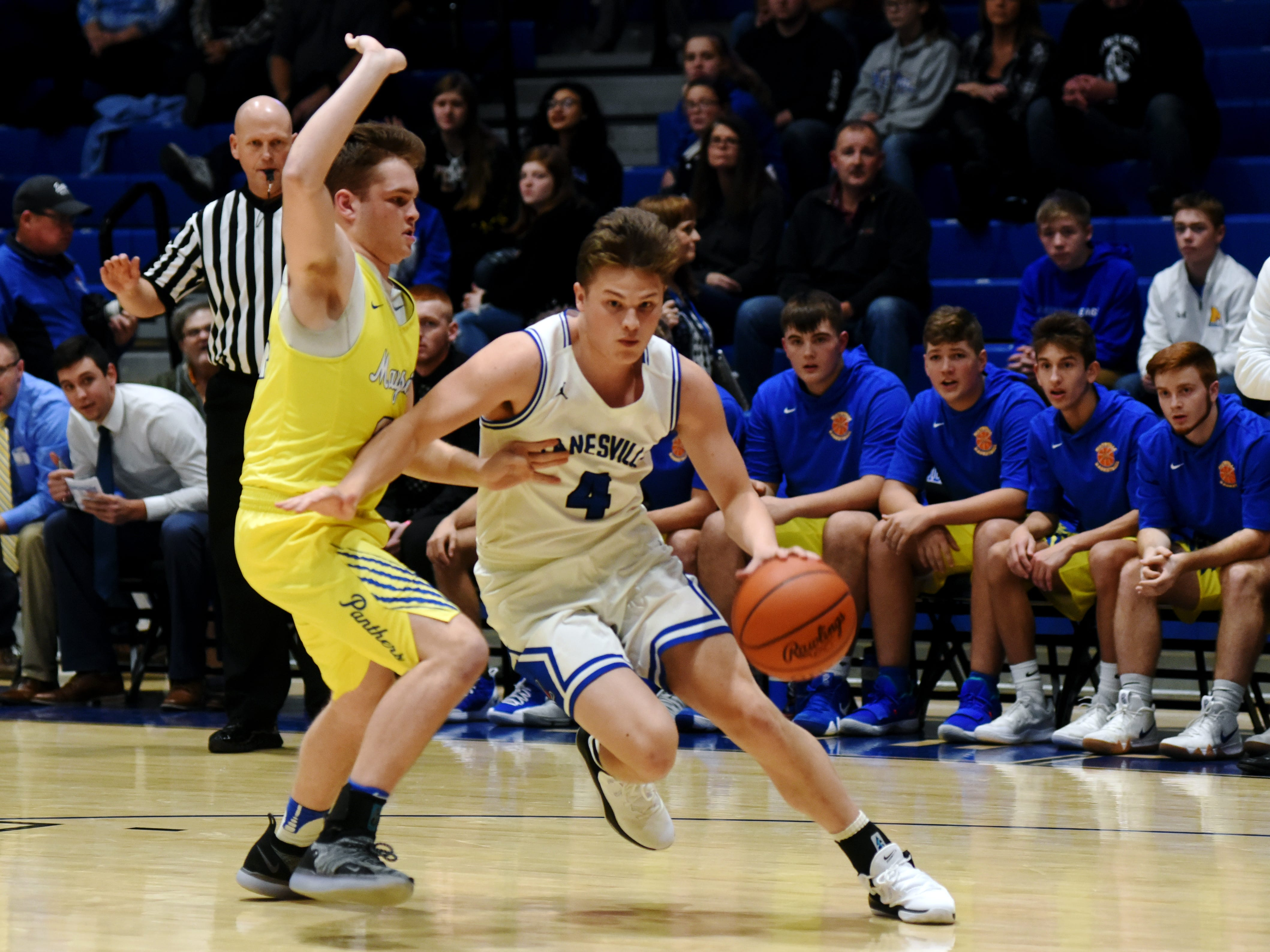 Clayton Foreman, of Zanesville, drives to the basket against Maysville's Kaiden Hartman.