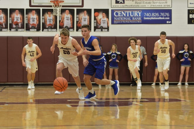 John Glenn's Parker Zachrich and Cambridge's Trent Valentine chase a loose ball in the Muskies' 48-40 win on Friday.