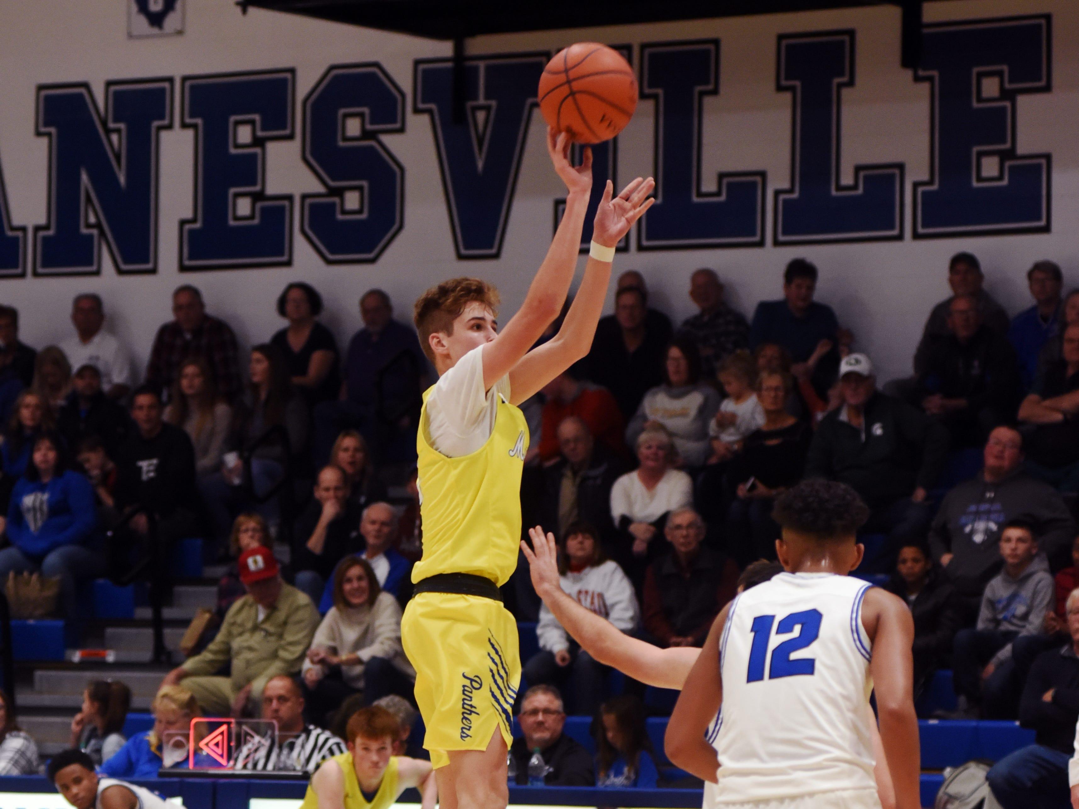 Kaiden Hartman shoots a 3-pointer for Maysville against Zanesville.