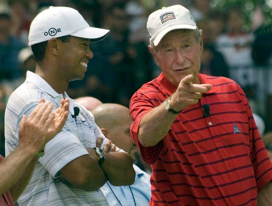 George H.W. Bush and Tiger Woods at a Pro-Am round at the AT&T National held at Congressional Country Club in Bethesda, Md. in 1997.