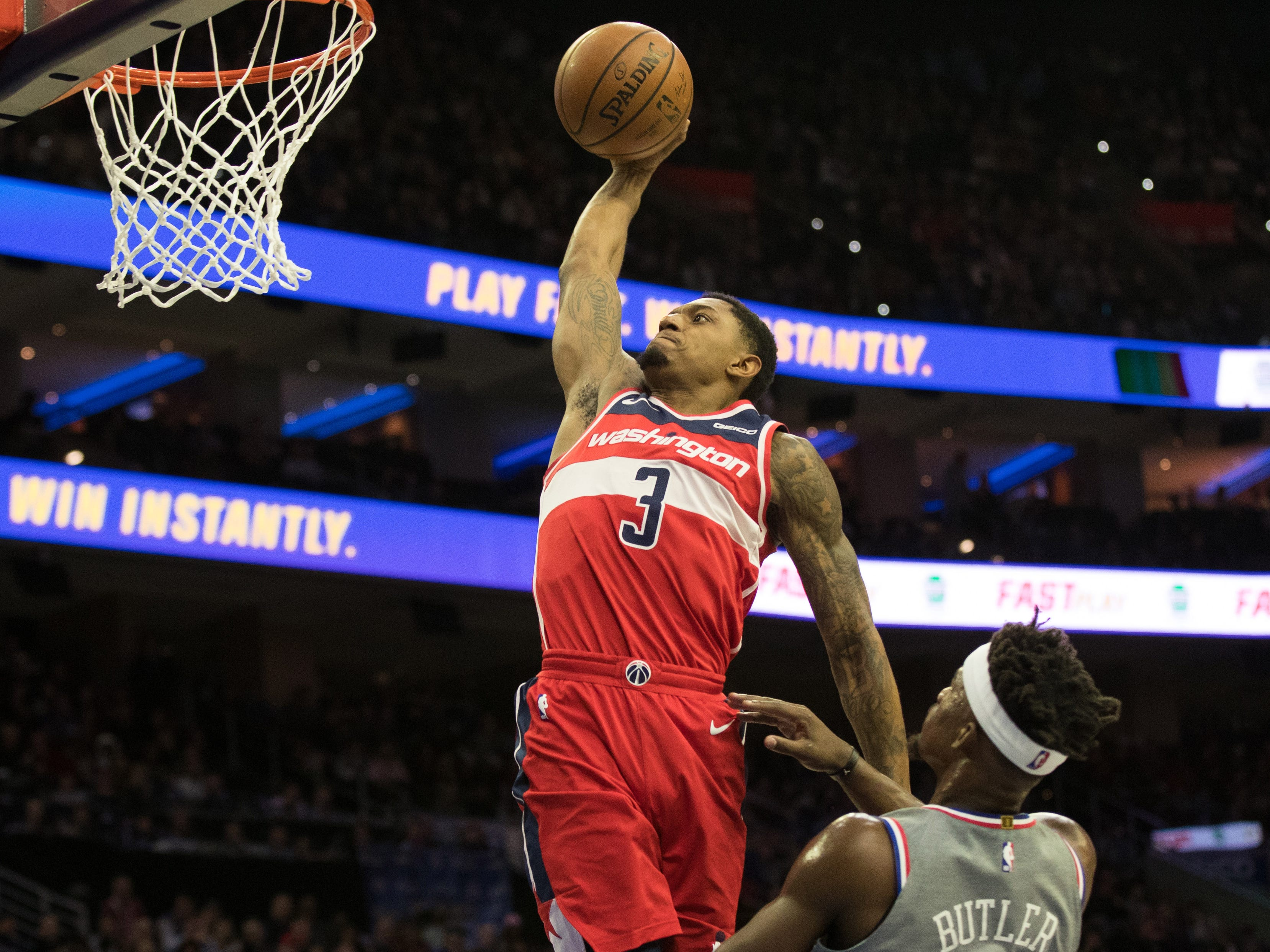 Nov. 30: Wizards guard Bradley Beal throws down a monster one-handed flush against the 76ers in Philadelphia.
