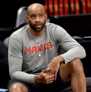 Vince Carter didn't pay Friday but still got hit with a technical foul on the bench.