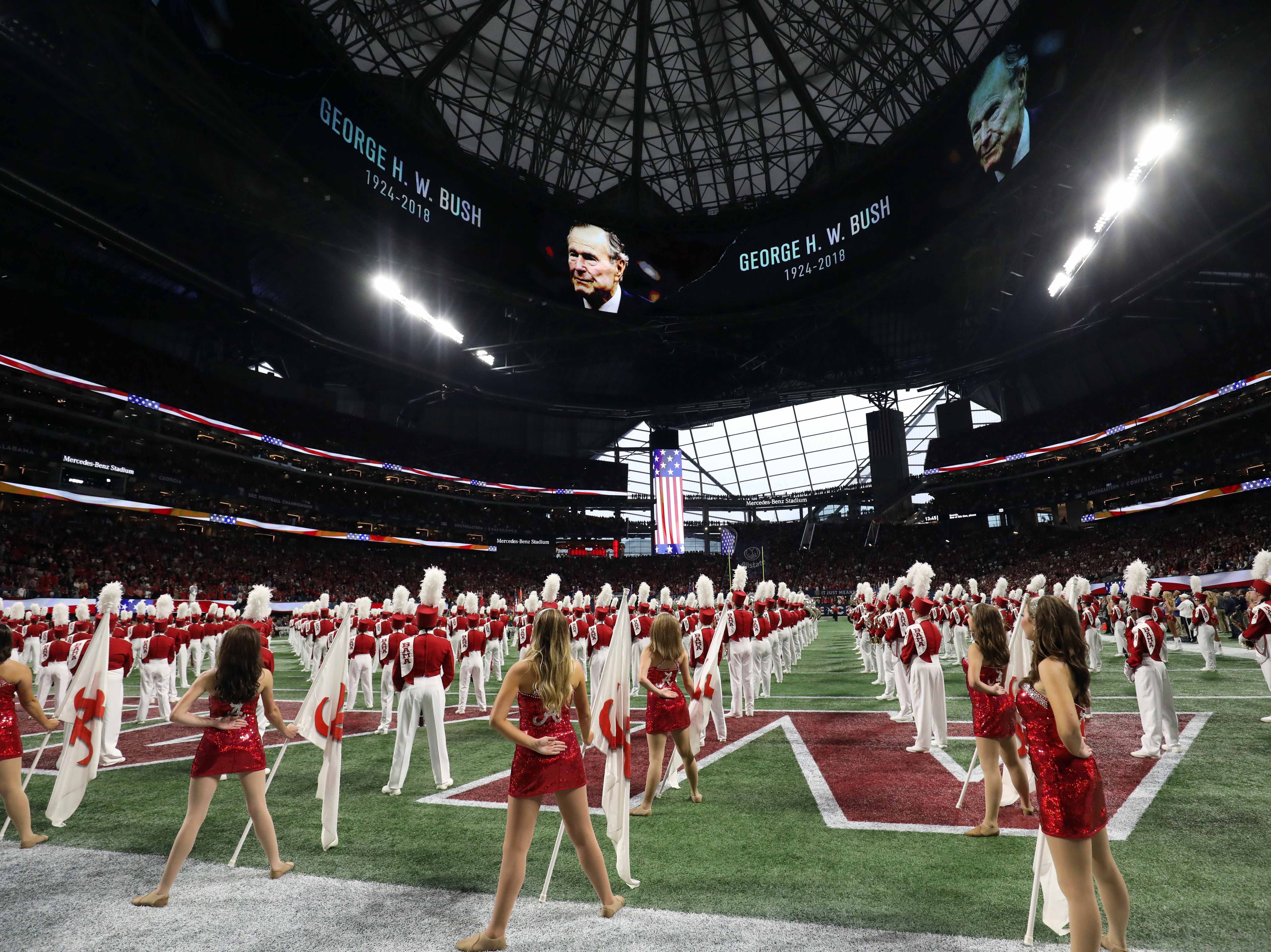 President George H. W. Bush is honored prior to the SEC championship game between the Alabama Crimson Tide and the Georgia Bulldogs at Mercedes-Benz Stadium.