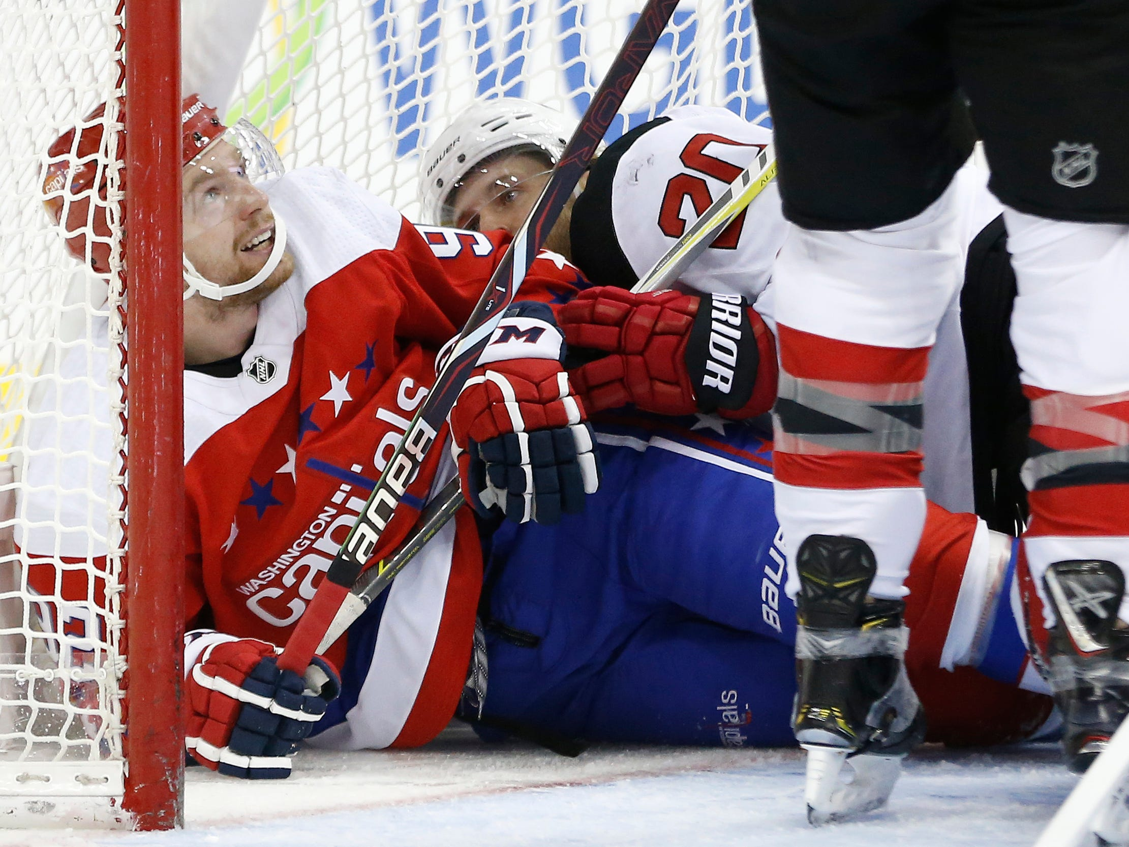 Nov. 30: Washington Capitals center Evgeny Kuznetsov, who returned from an injury absence, lies in the goal after being checked by New Jersey Devils center Blake Coleman.