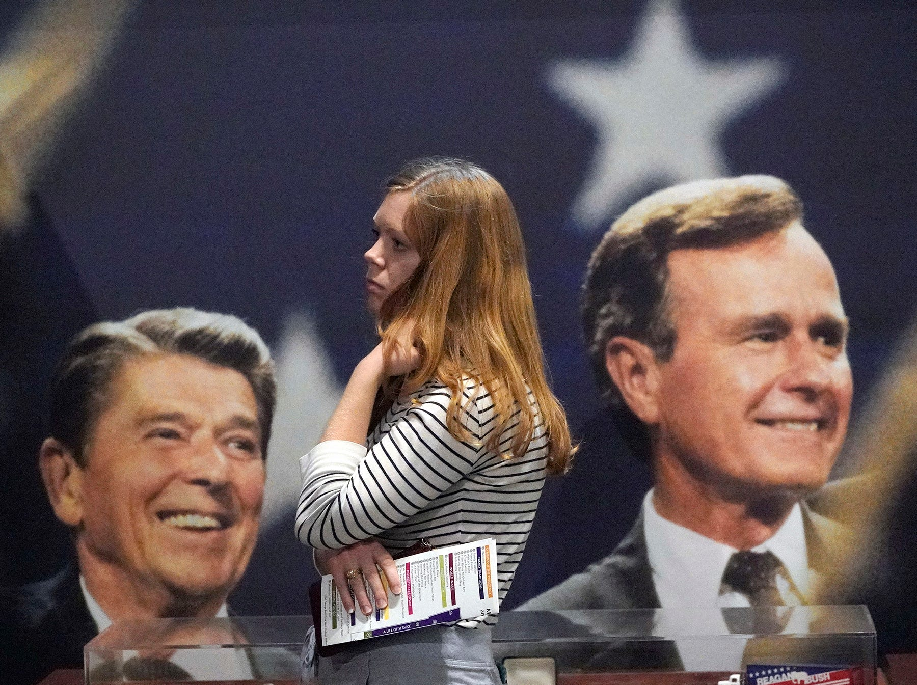 Caroline Cyboran, of Kingwood, Texas, looks at an exhibit while visting the George H.W. Bush Presidential Library and Museum Saturday, Dec. 1, 2018, in College Station. Bush has died at age 94. Family spokesman Jim McGrath says Bush died shortly after 10 p.m. Friday, Nov. 30, 2018, about eight months after the death of his wife, Barbara Bush.