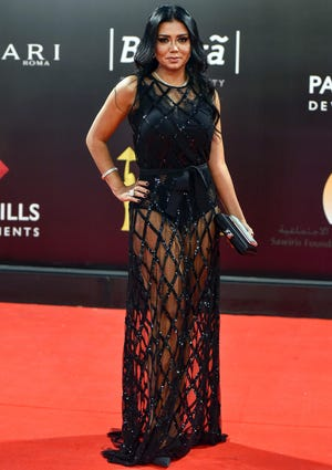 Egyptian actress Rania Youssef poses on the red carpet at the closing ceremony of the 40th Cairo International Film Festival at the Cairo Opera House in the Egyptian capital on Nov. 29, 2018.