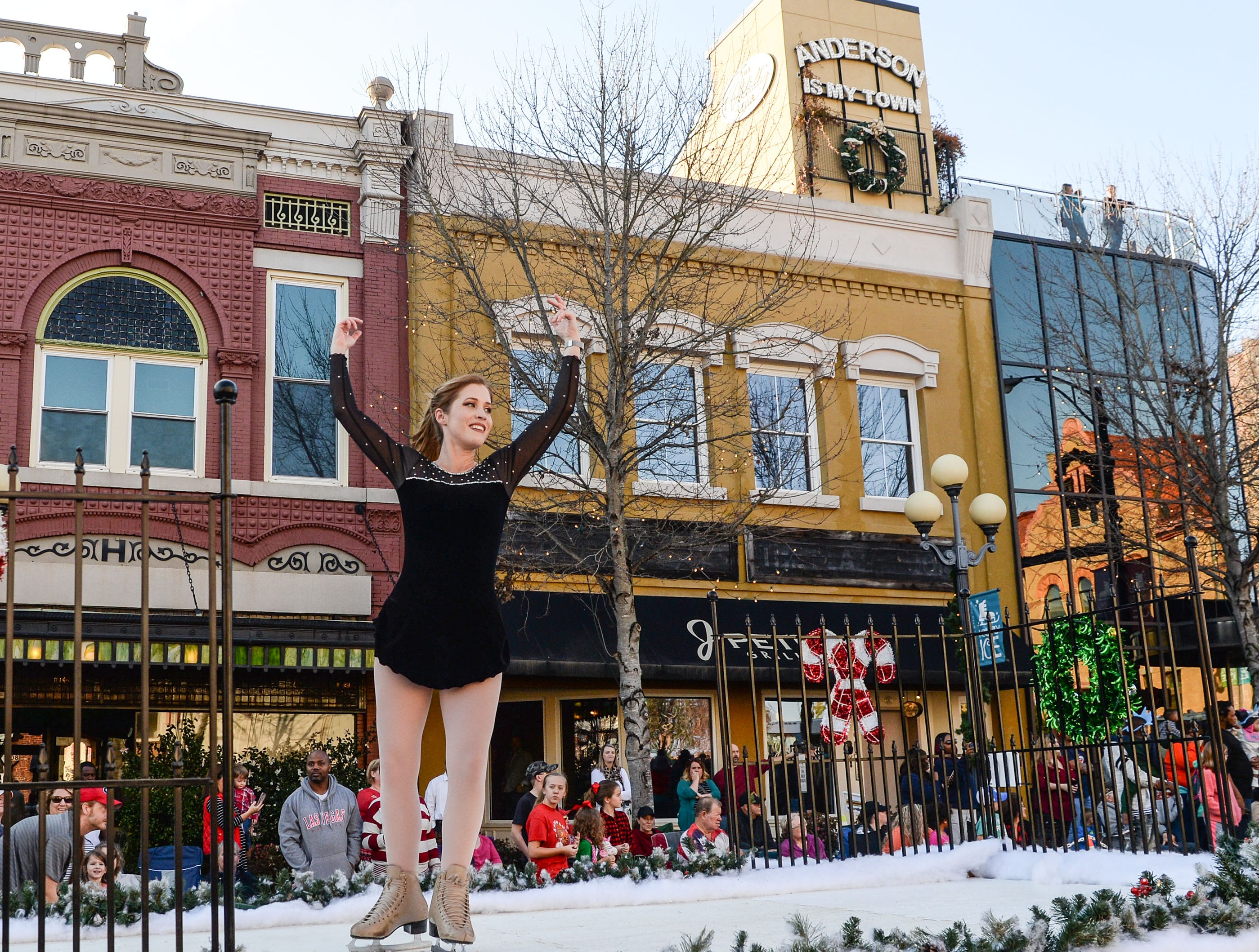 Jaci Boyd skates on artificial ice on a float in the City of Anderson Christmas Parade through downtown Sunday, December 2, 2018.