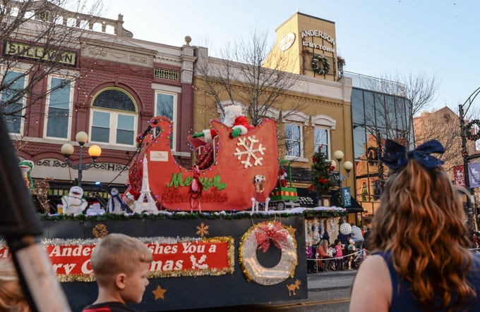 South Carolina: Santa Claus waves to people watching the City of Anderson Christmas Parade through downtown.