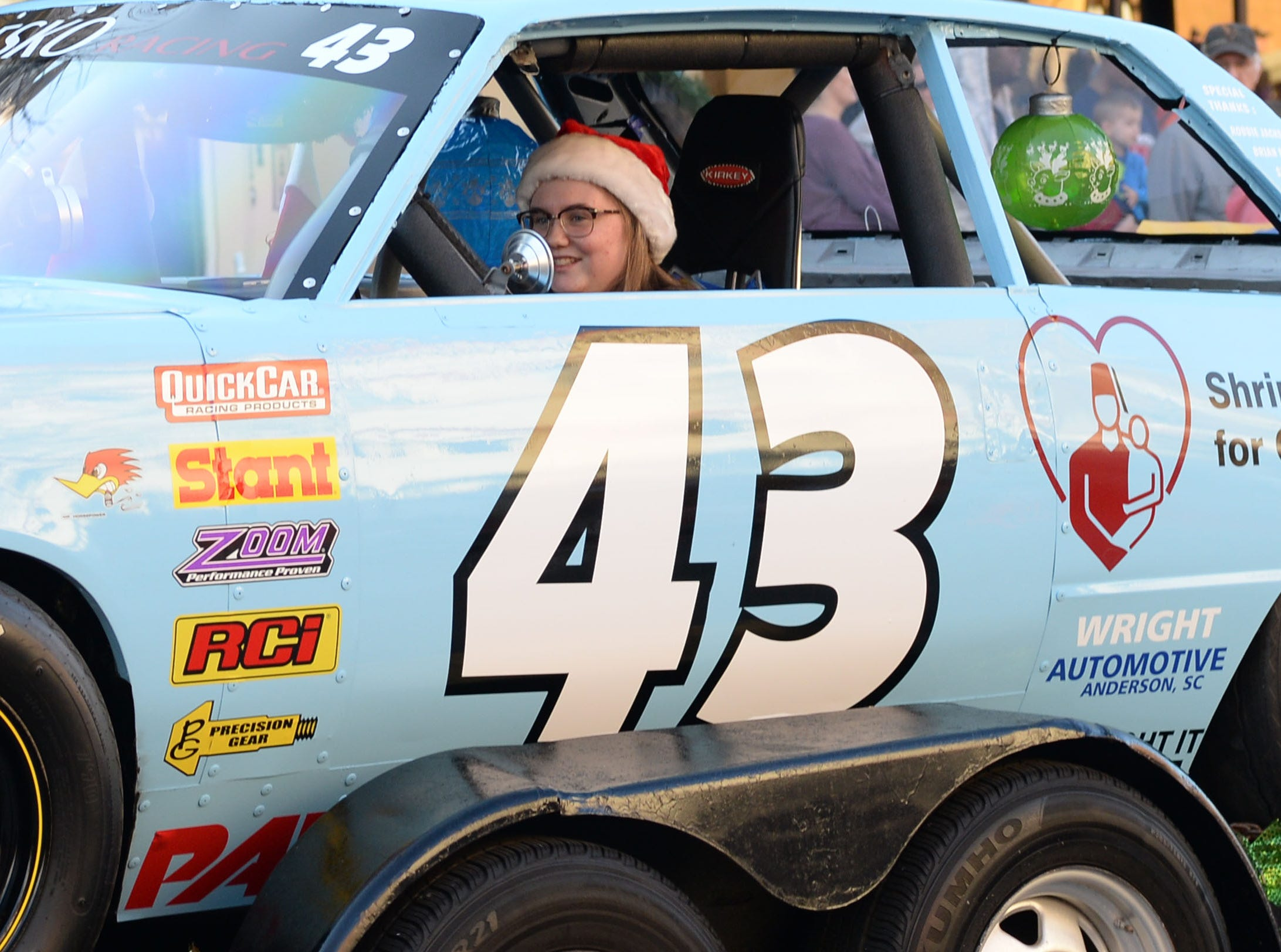 People gather to see community floats and Santa Claus in the City of Anderson Christmas Parade through downtown Sunday, December 2, 2018.