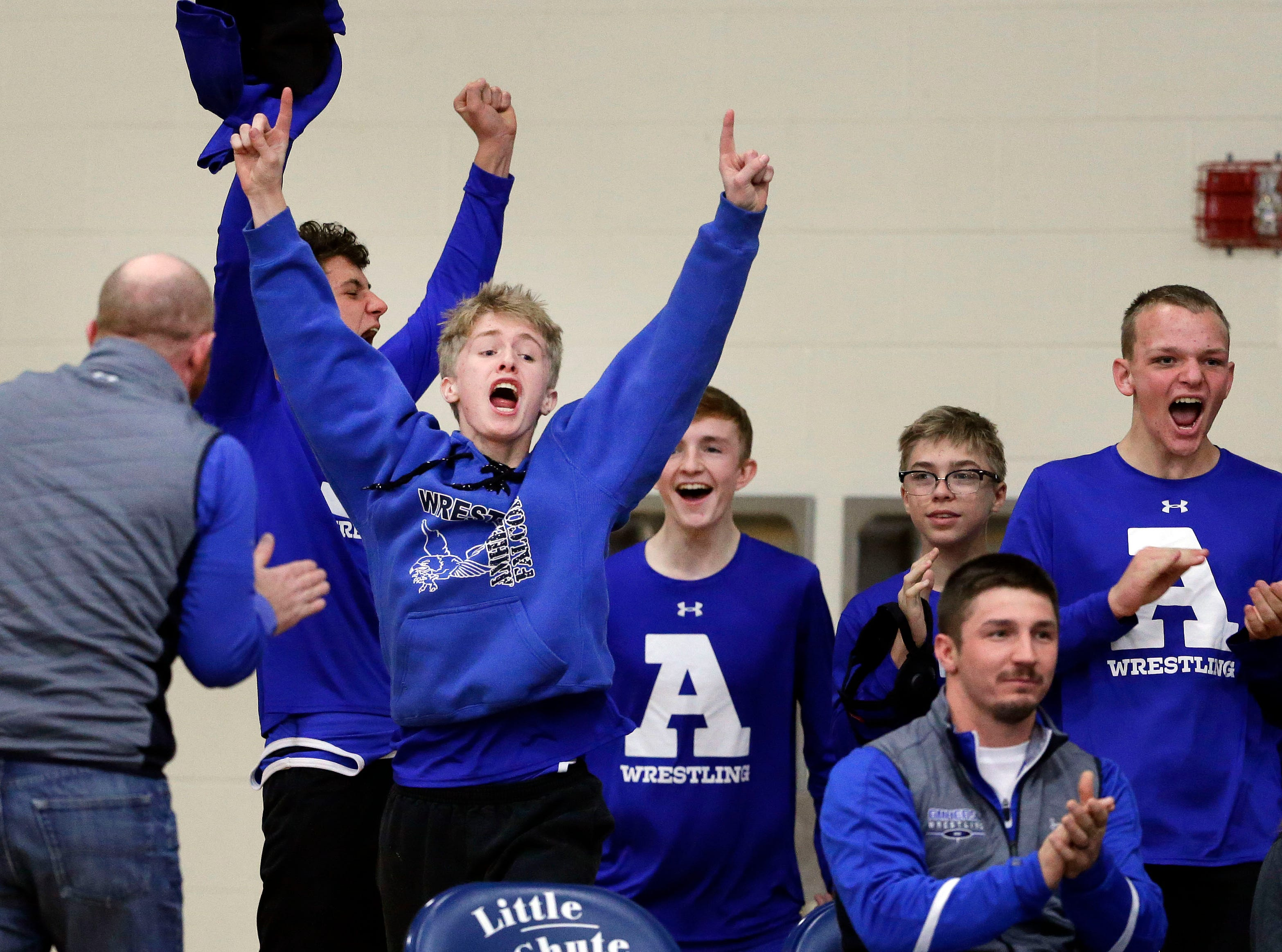 Amherst cheers for a win during the Sgt. Nick Mueller Memorial Wrestling Tournament Saturday, December 1, 2018, at Little Chute High School in Little Chute, Wis.