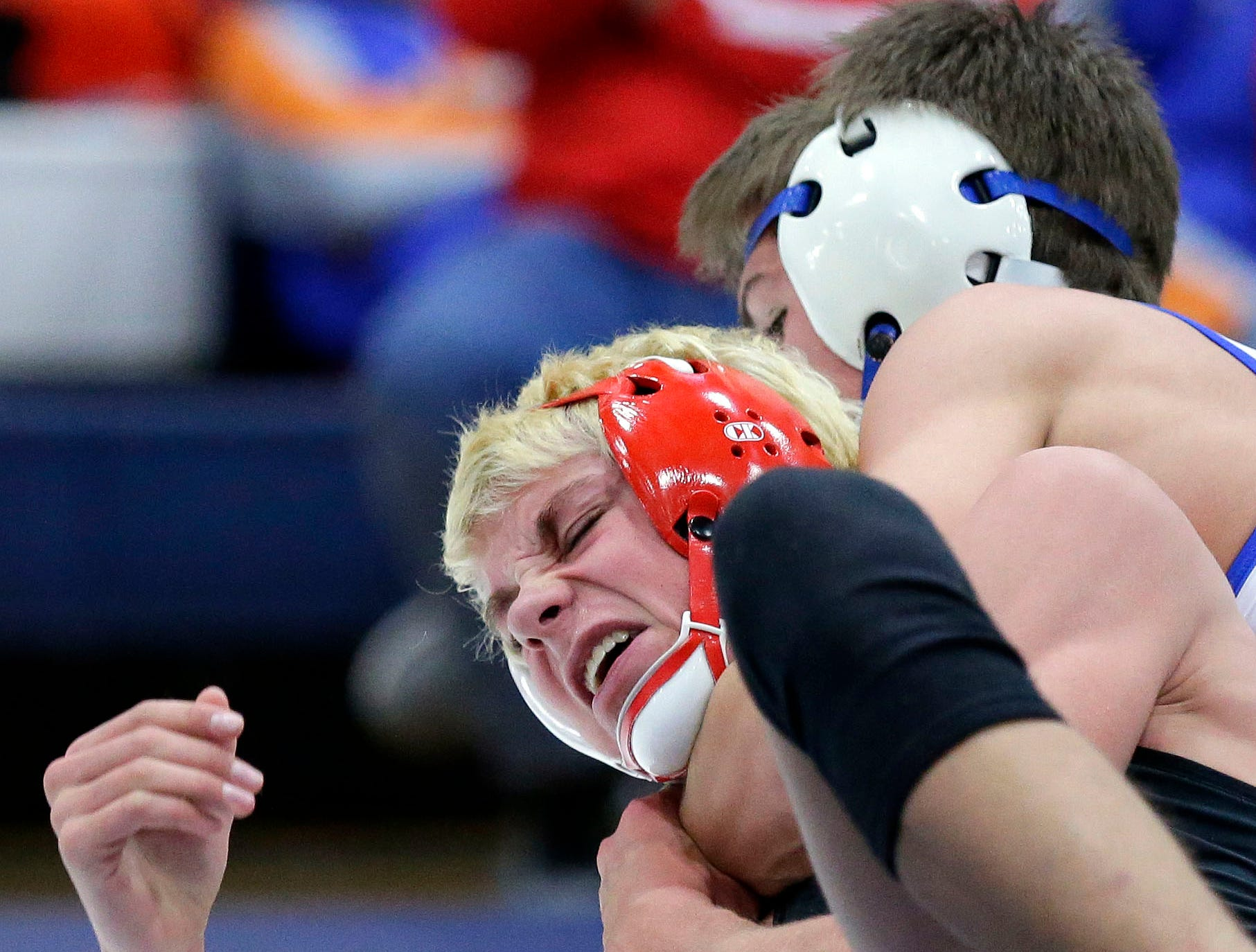 Sean Rietz of Wrightstown (right) wrestles Mason Marquette of Weyauwega-Fremont in the 132 weight class during the Sgt. Nick Mueller Memorial Wrestling Tournament Saturday, December 1, 2018, at Little Chute High School in Little Chute, Wis.