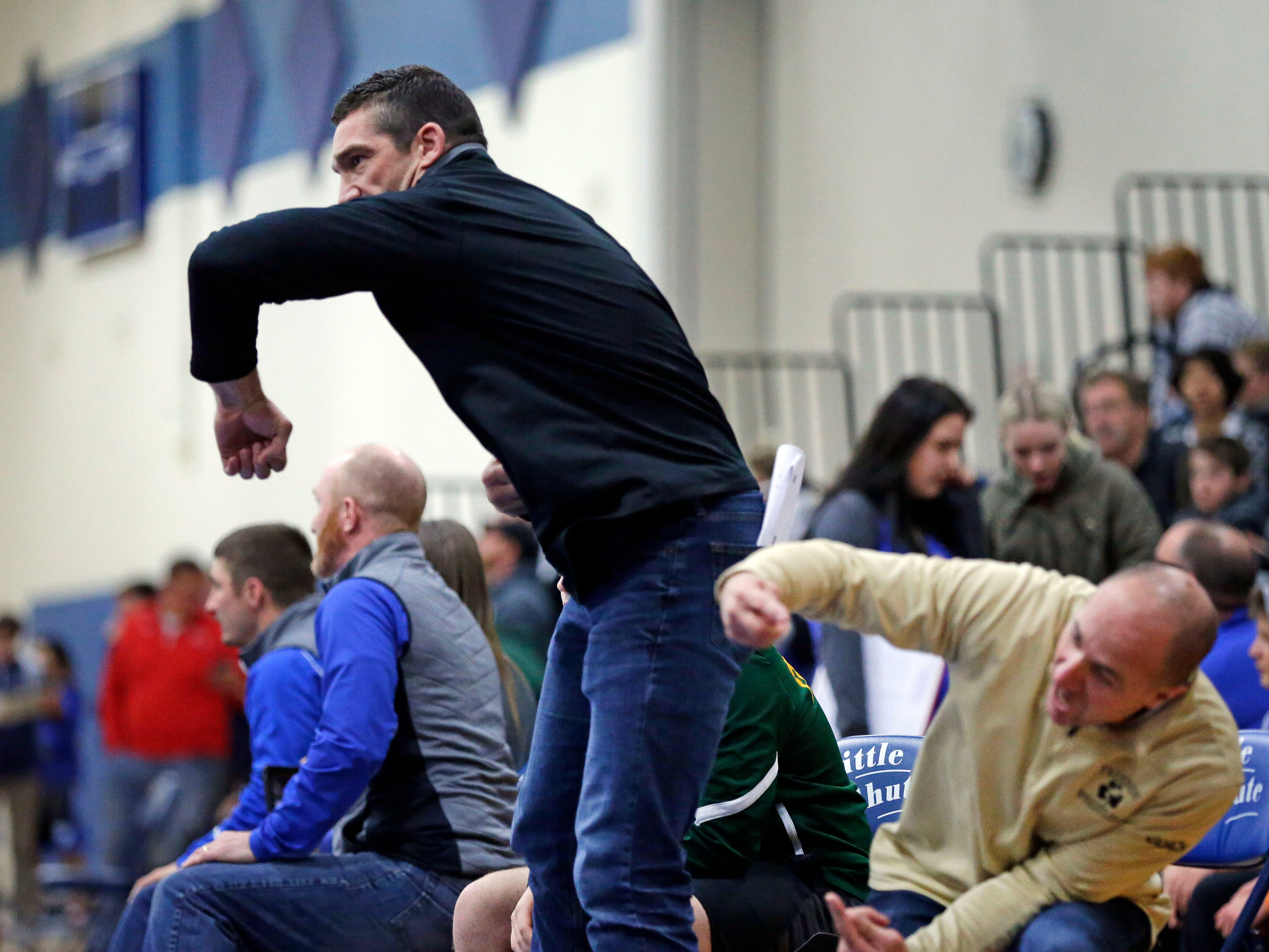 Freedom coaches give instructions to a wrestler during the Sgt. Nick Mueller Memorial Wrestling Tournament Saturday, December 1, 2018, at Little Chute High School in Little Chute, Wis.