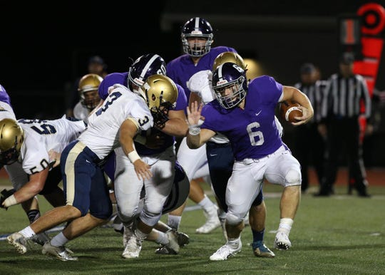 RFH's Alex Maldjian runs the ball during the first half of the Freehold Boro vs. Rumson-Fair Haven homecoming football game at Rumson-Fair Haven High School in Rumson, NJ. September 28, 2018.