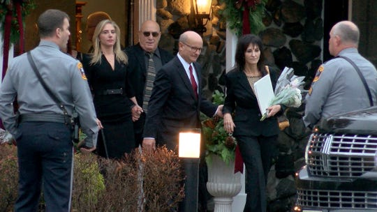 Family members depart the Holmdel Funeral Home after the viewing and funeral was held for the four members of the Caneiro family who were killed in an arson fire at their Colts Neck home.  Paul Caneiro has been charged in their deaths.