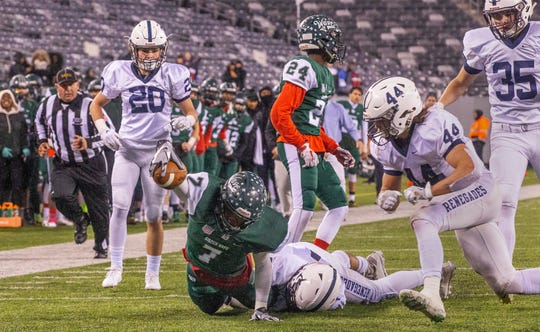Long Branch's Matthew Clarke stretches out as he helps set up Long Branch's first touchdown. Shawnee vs Long Branch in NJSIAA South Group IV Bowl Game in East Rutherford on November 30, 2018.