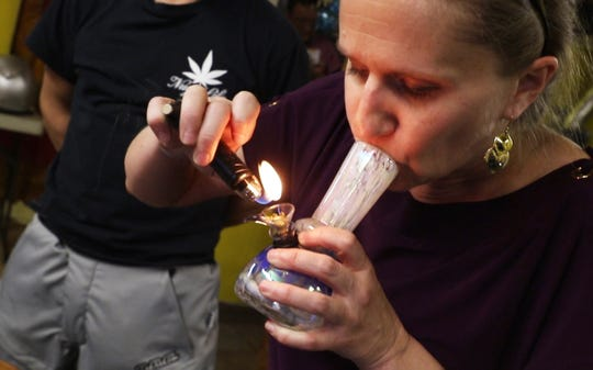 IBake Denver is a membership lounge where members can consume cannabis within the city limits of Denver without fear of breaking any laws. Members must bring their own supply. Mary Carniglia gets high in the lounge . Photo was taken April 12, 2018.