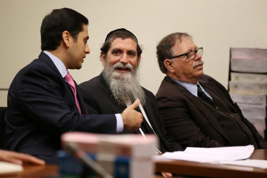 Rabbi Osher Eisemann,  founder of School for Children with Hidden Intelligence in Lakewood, appears for an arraignment on the new indictment alleging he stole $1 million in public tuition funds before Judge Benjamin Bucca at the Middlesex County Courthouse in New Brunswick, NJ.  May 25, 2018.