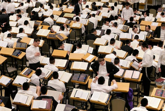 Students work in the study hall, which holds 1,000 students, inside the Herzka Building at Beth Medrash Govoha in Lakewood.