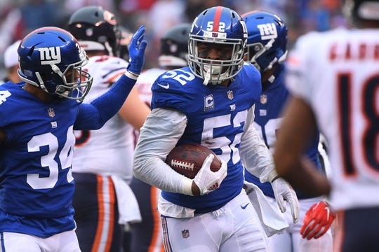 New York Giants linebacker Alec Ogletree (52) after an interception from Chicago Bears quarterback Chase Daniel (not pictured) in the first half at MetLife Stadium.