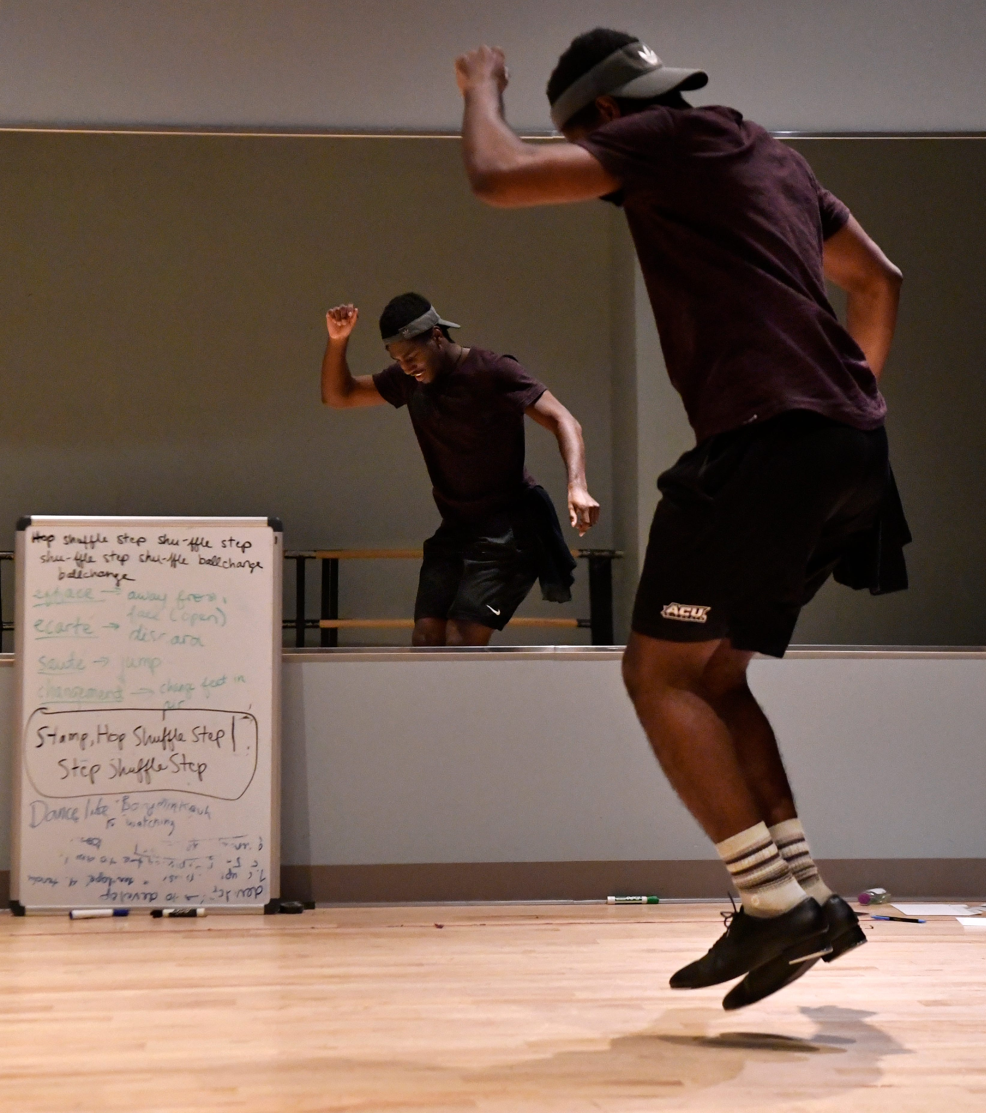 "Rehearsing for ""One Night Only,"" the first show performed by the new dance track at Abilene Christian University, Jeremiah Taylor taps in front of a mirror Dec. 1."