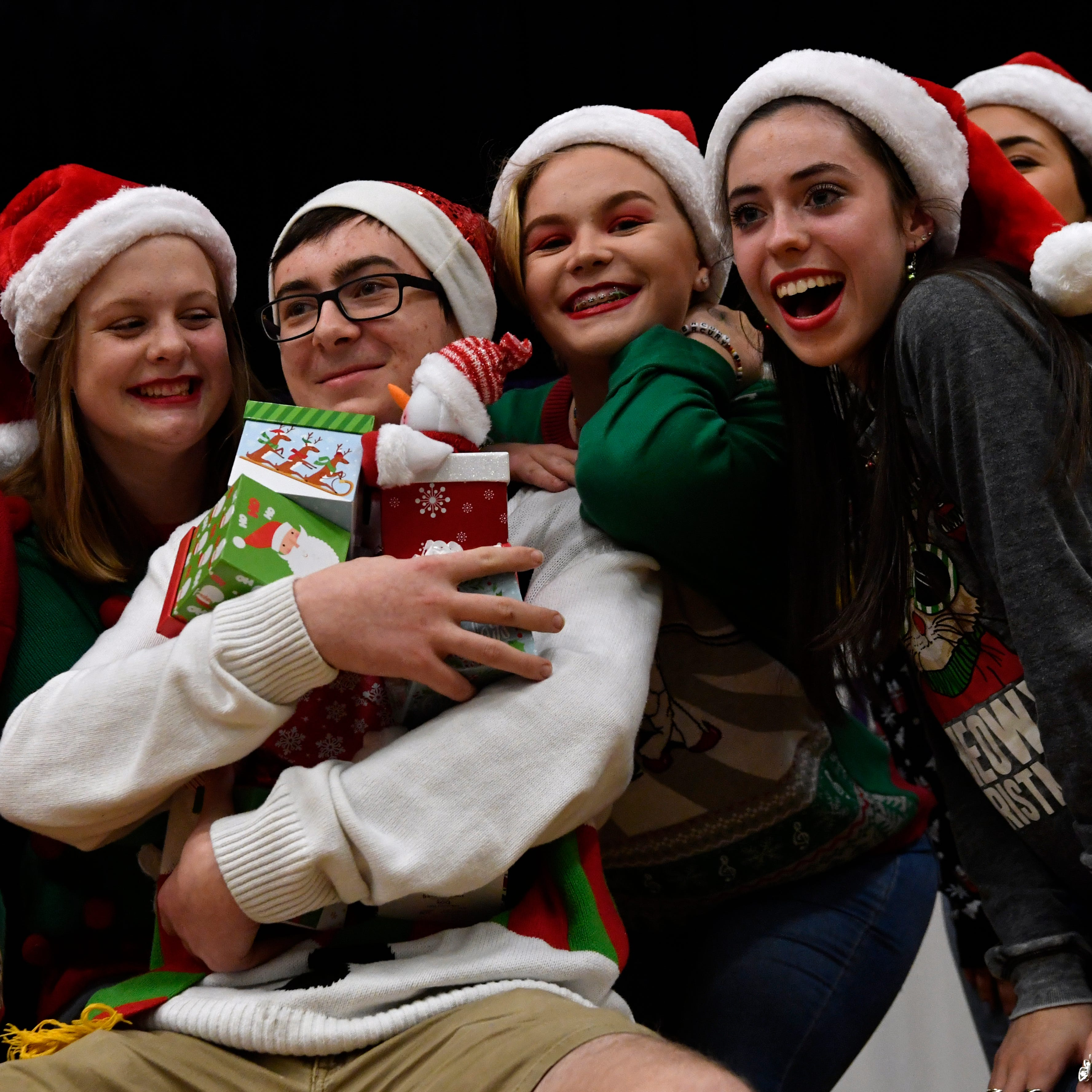 """Junior Alex Withers is surrounded by members of VocalPoint, the show choir at Wylie High School, during their performance of """"Santa Baby"""" at the Bulldog Christmas Market Thursday Nov. 29, 2018. This was the second year for the market which featured student-made products for sale in the high school's cafeteria."""
