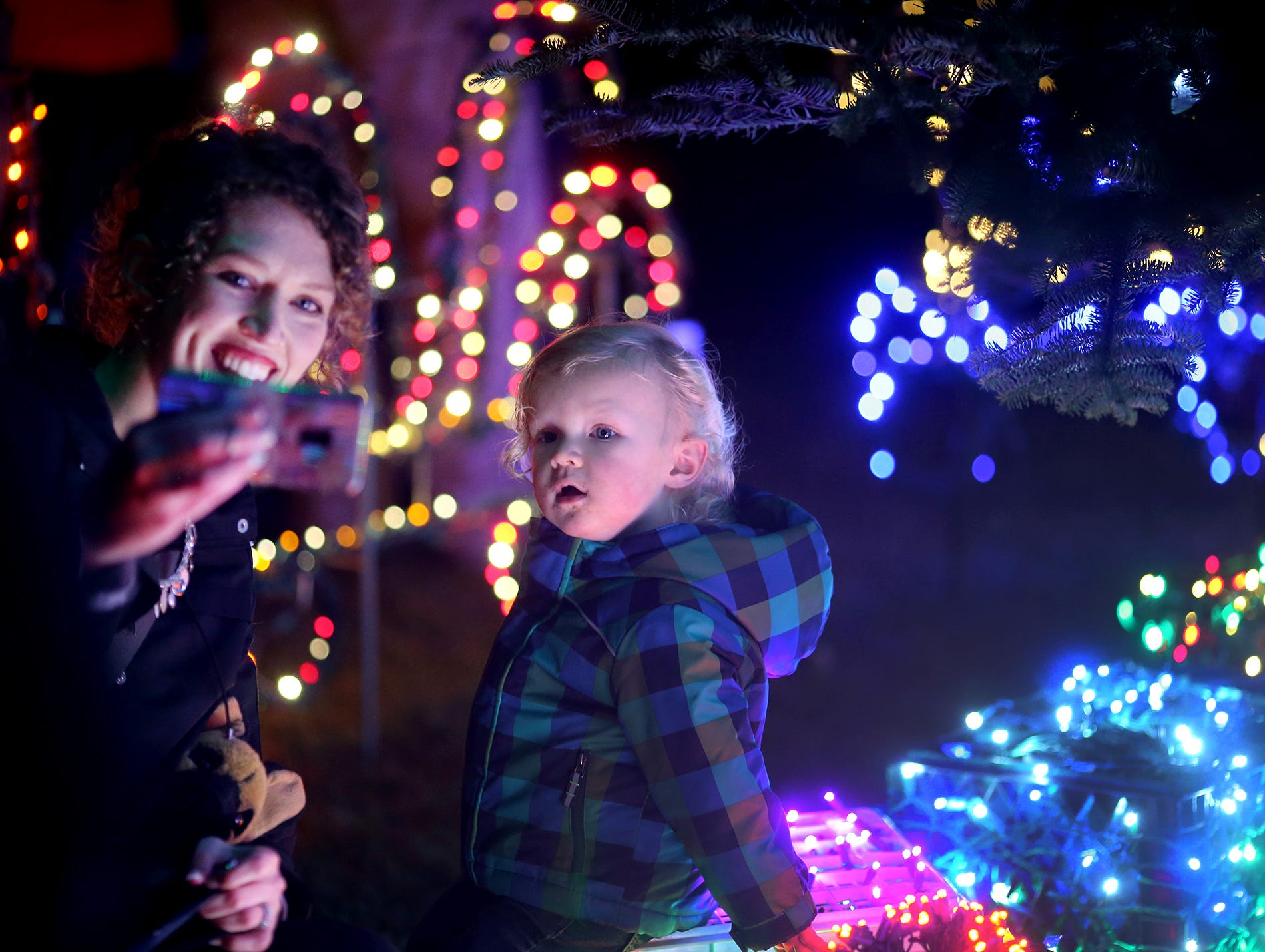 The Kingston Cove Christmas celebration on Saturday, December 1, 2018, at Mike Wallace Park in Kingston.The highlight of the event was the arrival of Santa and the Christmas tree, and park lighting. Camlyn Anderson,of Kingston  takes a selfie with her son Shay, 1, as he sits under the Christmas Tree that had just been turned on.